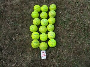 lot 2 of 18 yellow slow pitch softballs Dudley and TRUMP