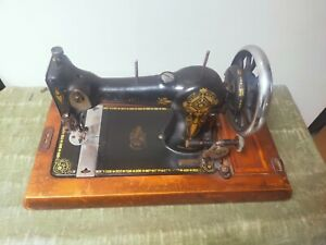 Simplex vintage manual sewing machine with wooden case