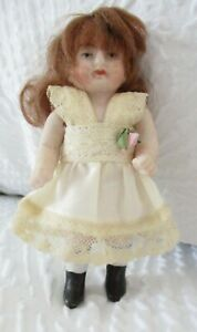 """4 """" Antique German All Bisque Doll With Original Wig"""
