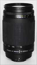 AF-Nikkor 70-300mm f/4-5.6 G zoom lens with caps and lens shade, fine.