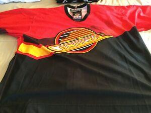 Vancouver Canucks 1995 pro alternate salmon jersey NWT size 54.