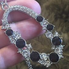 Deep purple stone covered amulet on chain necklace