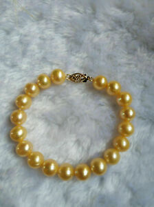 """stunning 7.5-8"""" AAA+ 9-8mm natural south sea gold pearl bracelet 14k Gold"""