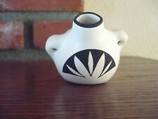 Very Small Pot. Only 2/12 inches tall. L Victoriano  5/91 Acoma New Mexico.