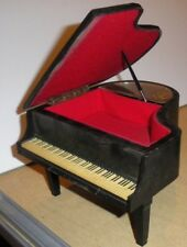 """Collectible piano shaped music box. Plays """"Love Story"""" I think."""