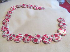 STRING OF ROUND PORCELAIN FLOWER BEADS ROUGHLY 20 ON A STRING RED/WHITE