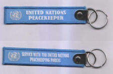 UNITED NATIONS PEACEKEEPER SERVICE WITH UN PEACEKEEPING FORCES KEY TAG 25X125MM