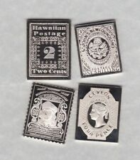 FOUR SILVER STAMP INGOTS IN NEAR MINT CONDITION