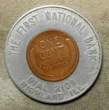Highland, Ill., The First National Bank, Dial 2109. Encased 1953D 1c, 35mm,