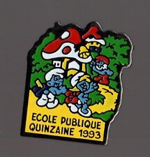 Pin's campagne de la Quinzaine de l'école publique 1993 / les schtroumpfs
