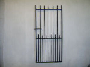 6 ft tall wrought iron  garden / side gate very strong hangs on the right !