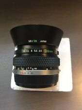 Olympus 28mm f/3.5 Auto-W - G.ZUIKO OM-SYSTEM WIDE ANGLE PERFECT OPTICS SUPERIOR