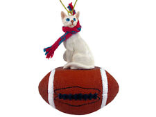 White Oriental Shorthaired Cat with Football Ornament