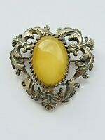 Vintage silver tone ornate brooch with large yellow glass central cabochon