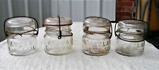 "Four Antique 1/2 Pt, ""Atlas E-Z Seal"" Canning Jar, Clear Glass, Wire Bale & Lid"