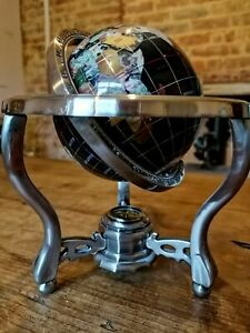 Table top globe decorated with semi precious stones and with a compass