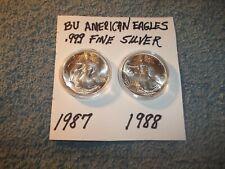 SILVER AMERICAN EAGLES LOT OF 2 , 1987, 1988 BU .999 1 OZ FINE SILVER COINS