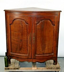 Antique French Provincial corner cabinet in walnut