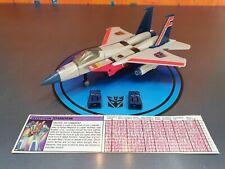 Transfomers G1 Starscream Decepticon solicitante de jet con las estadísticas de tecnología.