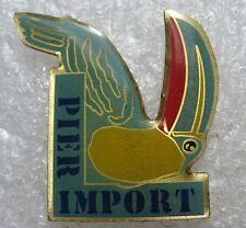 Pin's Pier Import avec un oiseau  (Réf: 2045)
