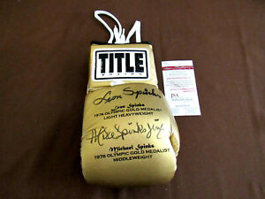 LEON & MICHAEL SPINKS 1976 OLYMPIC GOLD SIGNED AUTO TITLE BOXING GLOVE JSA GEM