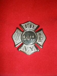 FIRE DEPARTMENT OF NEW YORK BADGE NUMBERED 0911