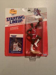 1988 Akeem Olajuwon RC Starting Lineup figure.   Rockets