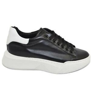 Sneakers uomo nero in vera pelle nero con riporto bianco fondo alto asimmetrico