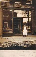 Birds eye view butcher standing in front of butcher shop real photo pc Z31221