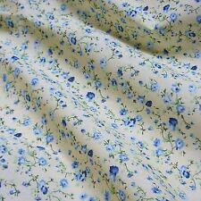 Crema Tela polycotton Con Delicadas Flores Azules * Por Metro