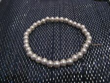 Wonderful simple small silver tone plastic beads elasticated