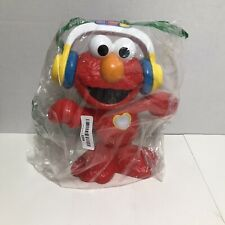 Sesame Street Lets Dance Elmo: 12-inch Elmo Toy that Sings and Dances  Headphone