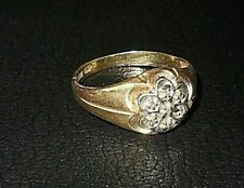 gold and diamond ring , cluster setting , 7 diamonds . size 91/2 .