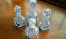 Four Light Blue Dressing Table Bottles, With Ground in Fitted Stoppers