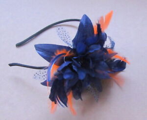 Navy blue and flower with orange feathers on a headband