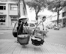 Photo.  1961.  Saigon, Vietnam.  Carrying Food