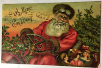 A Merry Christmas Santa Postcard 1908 Driving A Red Car Toys Tree Holly