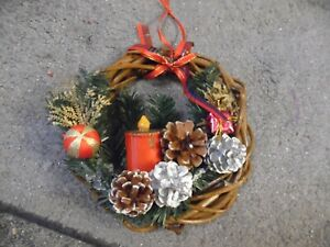 UNUSED 8 IN TWIG TWIST HANGING WREATH PINE CONES AND FAUX CANDLE