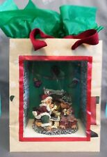 Dollhouse Miniature Santa and Mrs. Claus relaxing Roombox Scenario in a Gift Bag