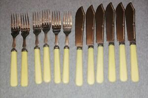 Set of 6 Fish Knives & 6 Forks by James Ryal