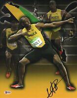 USAIN BOLT SIGNED AUTO OLYMPICS 11X14 PHOTO JAMAICA 9X GOLD BECKETT BAS COA 29