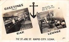 RPPC RAPID CITY SOUTH DAKOTA BUCKS BAR & LOUNGE REAL PHOTO POSTCARD (1940s)