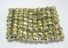 Connected Elasticated faceted gold tone plastic beaded bracelet