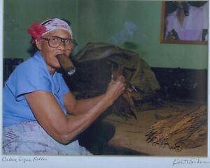 Cuban cigar roller smoking a stogey