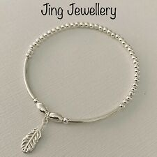 Sterling Silver Stretch Noodle Beaded Stacking Bracelet Feather Charm Handmade