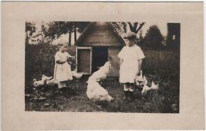 Children Feeding Chickens Chicken Coop Vintage RPPC Photo Postcard Farm Life