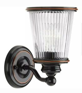 Progress Lighting Radiance 1-Light Rubbed Bronze Sconce with Ribbed Glass