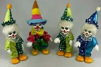 PORCELAIN CLOWN DOLLS SET OF 4 BEAUTIFUL PAINT AND DETAIL COLLECTIBLE VINTAGE