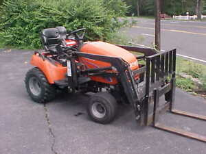 Simplicity Legacy Tractor with Loader and other Attachments  (Nice Shape)