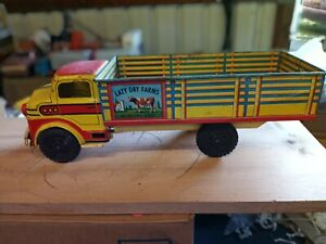 Vintage marx pressed steel toy lazy days farm stake truck. Good shape.